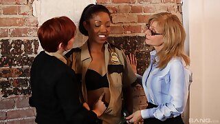 Interracial lesbian fucking on the table with sexy Nina Hartley