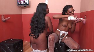 Insolent ebony sluts try the big dicks through the glory hole