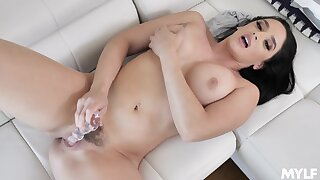 Sexy brunette toys her floccus snatch analogous to a demiurge