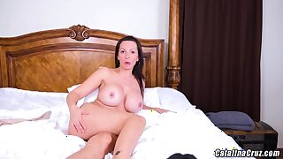 Catalina Cruz is making a new web cam turn and proudly showing her massive milk jugs