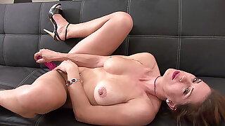 Ravishing busty MILF masturbates with her favorite toy