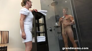 Old woman with high sex drive enjoys adhering young man inviting a shower before having sex