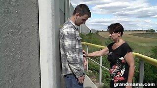 Mature woman deliver up 60 gives a blowjob near hot young guy outdoor